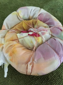 Spiraled silk stuffed with garden blooms, wrapped with copper wire